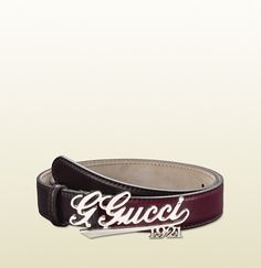 women's belt with 'Gucci 1921' script buckle.