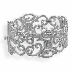 This elegant .925 Sterling Silver bangle bracelet has a Rhodium plated finish. Rhodium is a precious metal that is about ten times costlier than gold. Rhodium is gives jewelry a shiny, mirror-like ...
