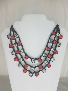 Hello and thank you for checking out my store! This item is a one-of-a-kind handmade crochet beaded necklace featuring skull beads. Perfect for all year round! Inspired by Dia de los muertos and traditional jewelery making from Mexico. Tie straps measure 12 inches long and you can easily wear this necklace close to your neck or lower on your chest. Please, if you have any questions regarding this item, contact me in my messages! 🌸 Message about custom orders!  🏡 Comes from a smoke and pet…