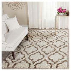 Classic tile motifs, beautifully displayed in subtle illusion, become lovely home décor in this plush shag from the Safavieh Hudson Collection. Rich brown motifs are set in a creamy, ivory shag pile that is comforting to the touch and wonderfully soothing to home furnishings, especially clean-lined, modern décor. Power-loomed using durable, easy-care synthetic yarns that will keep their luxurious look and feel year after year.