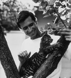 Anthony Perkins with his pet cat at home in Los Angeles, CA, 1959.