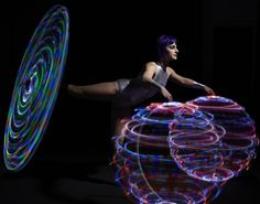 The Hula Hoop Dancer is an experienced hula hoop dancer, circus and fire performer. Her unique style of hoop manipulation results from her background of dance, acrobatics and contortion. Led Hula Hoop, Jonathan Green, Circus Acts, Party Hire, Flow Arts, Contortion, Futuristic, Acting, Carnival