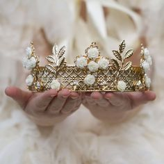 This lovely half crown tiara is adorned with a gold design and creamy roses. Would make an excellent prop for a little royal princess!