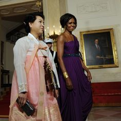 First Lady Michelle Obama walks with South Korean first lady Kim Yoon-ok in the Cross Hall as they arrive for a State Dinner at the White House in Washington, DC on October 13, 2011. The State Visit comes only a day after congress passed a free trade agreement with South Korea. (Photo by Roger L. Wollenberg/Pool/Corbis via Getty Images)