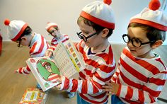 Young visitors dressed as the 'Where's Wally' character assemble at Foyles Book Store in central London