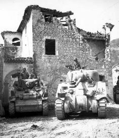 US tanks in Coreno Ausonio, Italy, on 14 May 1944. The same tanks, manned by Americans, were attached to the French mountain troops making a drive from the Castelforte area on the right flank of the Fifth Army, through the Aurunci Mountains and into the Liri Valley. M5 Stuart light tank (left), M4 Sherman medium tank (right).