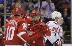 Detroit Red Wings left wing Tomas Tatar, center, is congratulated by left wing Henrik Zetterberg after scoring during the second period of an NHL hockey game against the Washington Capitals, Nfl Highlights, Hockey Games, Washington Capitals, Left Wing, Detroit Red Wings, Nhl, Period, Two By Two