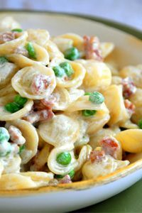 "Orecchiette with Peas, Pancetta & Cream Recipe ~ These ""little ears"" perfectly scoop mouthfuls of tender green peas and crispy pancetta in each bite. You can substitute ricotta in place of the cream if you want to lighten up on the calories."