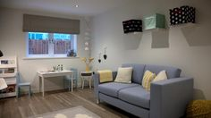 Flexible space adjacent to the kitchen is ideal for use as a playroom.
