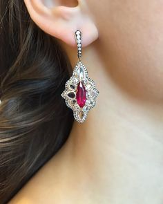 Ruby Earrings : The elongated form of these ruby and rose cut diamond earrings brings out a very elegant appeal. Ruby Jewelry, Ruby Earrings, Stone Earrings, Diamond Earrings, Fine Jewelry, Pierced Earrings, International Jewelry, Diamonds And Gold, Rose Cut Diamond