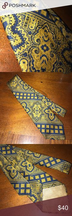 Vintage Designer Necktie Vintage Navy & Gold abstract Christian Dior Necktie in excellent condition. There is some discoloration on the backside but the front is pristine! Christian Dior Accessories Ties