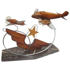 French Art Deco Airplane Sculpture | From a unique collection of antique and modern aviation objects at http://www.1stdibs.com/furniture/more-furniture-collectibles/aviation-abjects/
