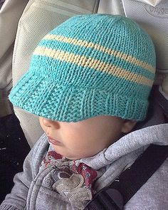 Free Knitting Pattern for Skater Baby Hat - This baby hat with brim is knit in the round. Size 6-12 month. Designed by Emily Vanek. Pictured project by amandaindie and coffeebra