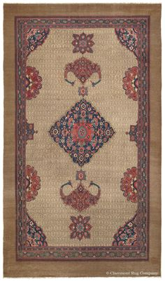 Serab Camelhair, 7ft 9in x 13ft 10in, 3rd Quarter, 19th Century.  Possessing an inviting, stately air, this highly engaging antique Serab carpet offers a casual elegance. Perfectly proportioned pendants and colorful accents frame its painstakingly crafted diamond medallion, supported by the reserve's understated monochromatic patterning. The natural luminosity of pure camelhair adds a soft warmth, greatly enhancing the allure of this village art carpet.