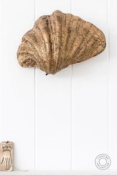 Eccentric luxury designer wall light, if you want the unique look this handmade Gold Shell Wall Light will not disappoint. The organic and textural qualities of this piece make for a piece that will enliven and compliment a range of interior settings. #eclectic #eclecticlight #eclecticstyle #wallight #eclecticinterior #interiordesign #interiorlighting