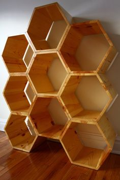 S I Z E + O P T I O N S  This versatile honeycomb structure stands impressively at nearly 4.5 feet tall and more than 3.5 feet wide.  Actual overall dimensions are 43.75 wide x 53 high. Each hexagon in this unit measures 17.5 wide x 15.15 tall x 11.5 deep, features approx. 8.25 wide interior shelf ledges, and is built of 3/4 thick lumber. You may request to alter the design by adjusting the height, width, or depth. Customize this honeycomb piece to suit and display whatever you wish, while…