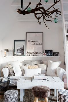 Layers of cushions and blankets keep this monochrome scheme warm.