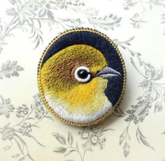 Hand embroidered yellow bird brooch