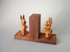 2 lovely Vintage midcentury modern wooden hand carved dog bookends wood set terrier dachshund Danish Modern 70s or 60s book ends puppy brown by LeKosmosBerlin on Etsy https://www.etsy.com/listing/230566039/2-lovely-vintage-midcentury-modern