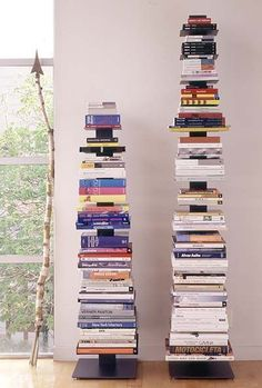 Sapien Bookcase  Designed by Bruno Rainaldi  When he designed his Sapien Bookcase (2003), he created a unique solution for those with a lot of books and little space to store them. By holding texts horizontally in a vertical stack, the tall Sapien can accommodate up to 70 small and large books in a very compact footprint. When fully loaded, the bookcase virtu¬ally disappears behind the books. All-metal construction and a heavy, weighted base ensure the design's strength and stability.