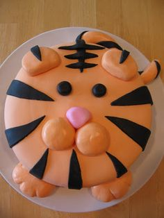 I must admit that I cheated a little bit on this cake. Being eight months pregnant I ordered an eight inch round frosted with buttercream f. Tiger Cupcakes, Tiger Cake, Candy Cakes, Cupcake Cakes, Funny Cake, Animal Cakes, Occasion Cakes, Cute Cakes, Cake Creations
