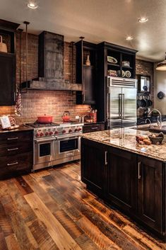 Warm and dramatic kitchen with brick details. Achieve this look with Glen-Gery! Visit www.glengery.com explore our products!