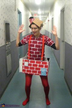 Holly: I am wearing my costume in the picture. I made the boxy part with red poster board and white paint, then made a paper door and window to go on...