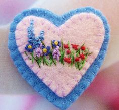 embroidered heart...I think I would add some pretty beads too.