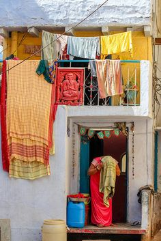 A woman drying her hair and her laundry