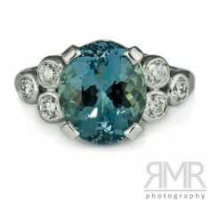 Aquamarine fleur-de-lis engagement ring Oval aquamarine with trefoil set shoulder diamonds set in platinum. Rumour Jewellery developed the design from the bottom up to be totally original. - RMRayner Photography