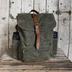 The Rogue Backpack is ideally sized both for jam-packing or light toting! It is a modern re-creation of a classic scout pack and is steeped in the traditions of exploration and adventure. As one scout motto advises: 'Better to have it when you need it, than to need it and not have it.'  DETAILS - 15 oz. waxed duck canvas (19 oz. with wax) - Adjustable reclaimed leather shoulder and closure straps - Leather from well-worn vintage gunslings - Steel buckles and snaps - 2 black steel snaps at…