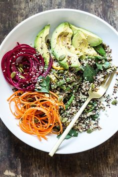Summer Glow Buddha Bowl with Quinoa   Vegan, gluten free, and vegetarian.   Click for healthy recipe.   Via Oh She Glows