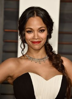 For the big Oscars red carpet, Zoe Saldana rocked a chic chignon. However she went for a more casual braided look at the Vanity Fair after-party, which she paired with her signature red lip.