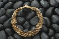 This necklace from 600 B.C. was found in a Danish bog.  Location:Copenhagen, Denmark.  Photographer:SISSE BRIMBERG/National Geographic Stock