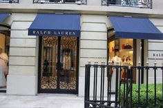 gorgeous RL storefront . blue , black & gold . love the awnings in blue + gold lettering .