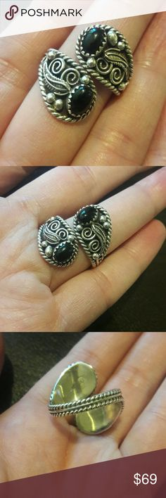 Beautiful Vintage Navajo Sterling Onyx Ring Adjustable ring, currently SIZE 8. Can be moved up a size or down  a size. Black Onyx stones marked STERLING SC inside band. Vintage Jewelry Rings