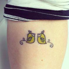 Julie West birds. left elbow tattoo