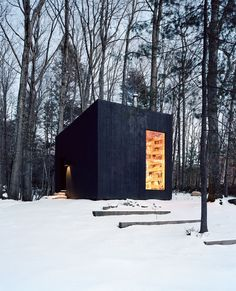 """This little black cabin, built by Studio Padron, is actually a library and guest house for a vacation home in upstate New York. Appropriately, it's called Hemmelig Rom — """"secret room"""" in Norwegian. Winter Cabin, Cozy Cabin, Cozy Winter, Ideas Cabaña, Ideas De Cabina, Cedar Cladding, Cozy Living Spaces, Cabin In The Woods, Secret Rooms"""