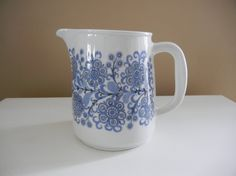 This pitcher is beautiful! Made in Finland by Arabia, it features the Orri pattern, and designed by Kaj Franck. It is in very good