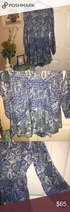 Free People Dress Beautiful blue Free People dress! It has a opening in the back as shown in the pictures and oversized sleeves & two front pockets! Perfect for vacation or a day at the beach. Absolutely love this dress however it is to big for me, I am a true Small and got this in a Medium. Free People Dresses