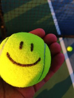 Smile if you love tennis . . .