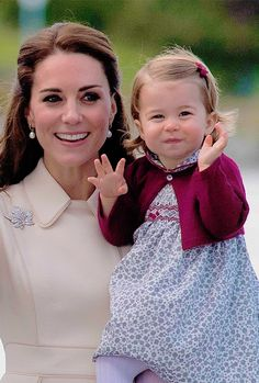 Catherine with her daugther, Princess Charlotte, during the 2016 Canada tour ""