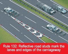 Reflective road studs mark the lanes and edges of the carriageway
