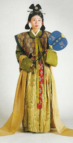 """Scan N3: Court lady of the Nara Period (710-784) , Japan. Textiles during this period of Japan were often brocade ones heavily influenced by China (and in some cases the cloth itself was directly imported from that country) . Scan from book """"The History of Women's Costume in Japan."""" Scanned by Lumikettu of Flickr. Japanese costume many centuries ago…recreation accomplished in Kyoto during the 1930's"""