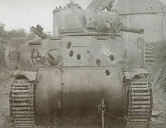 Massive penetration holes again on another allied Sherman tank!!  I think they used to call them Purple Heart boxes