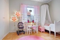 girly girl room. white canopy over the bed.