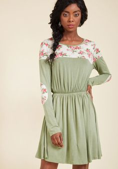 <p>With this olive green dress, you may think you're just getting an outright adorable look, but in reality, you're in for so much more! With this jersey frock's ivory patches 'round the neckline and at the elbows blossoming with pink flowers, you'll revel in the benefits of darling detailing.</p>