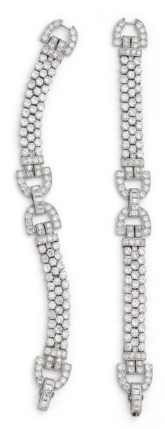 A pair of Art Deco diamond bracelets, circa 1930. Each designed as a highly articulated strap of old brilliant-cut diamonds connected by openwork buckle motifs millegrain-set with old brilliant and square-cut diamonds, with a concealed clasp, mounted in platinum. #ArtDeco #bracelet