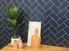 Beautiful blue herringbone tiles for kitchen splashback.