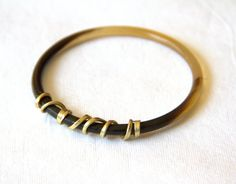 Horn bangle with twisted brass detail by boutiqueboheme on Etsy, £16.00